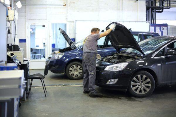mechanic fixing car lifting hood